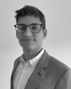 picture of Clemens Murer wearing glasses and suite