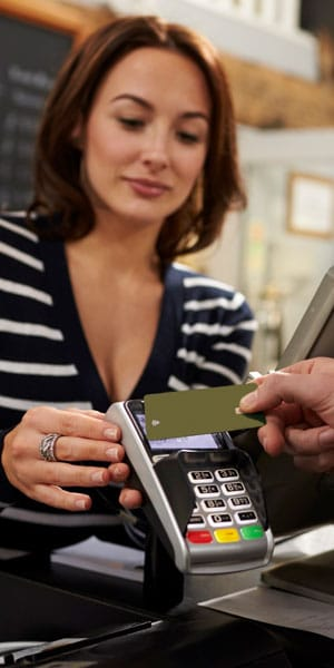 woman helping with contactless payment by smart card and rfid reader
