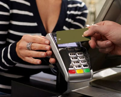 contactless payment with rfid card at terminal in a store
