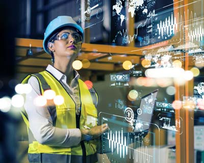 woman controlling manufacturing processs via computer