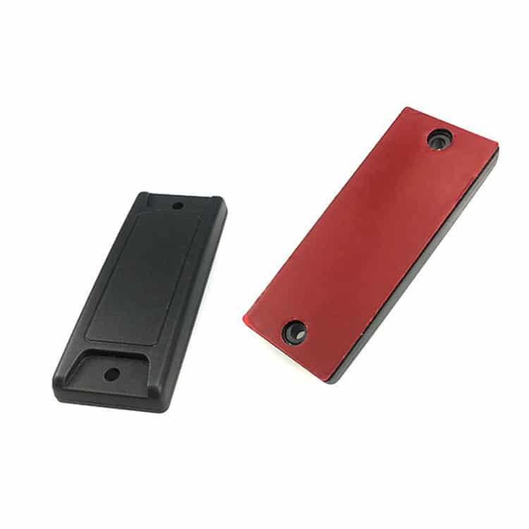 front and back of two black rfid anti-metal tags