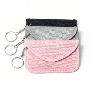 three rfid blocking bags with oxford fabric in black, grey and pink colors