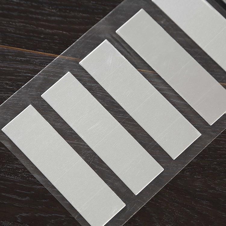 Anti-Metal uhf rfid tags on flat wooden surface