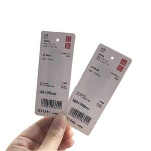 rfid paper hangtags from uniqlo showing rfid chip shining through