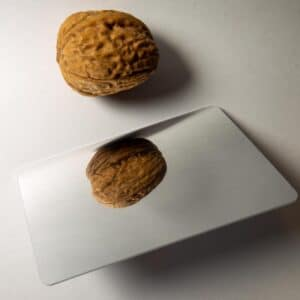 rfid smart card with mirror surface next to a nut